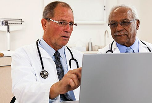 Two doctors viewing and discussing patient test results.