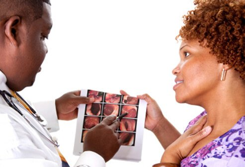 A doctor discusses a female patient's colonoscopy results.