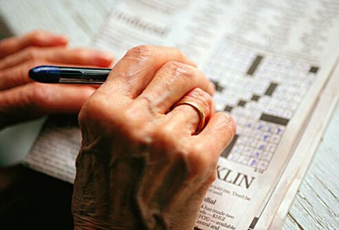 A woman with dementia doing a crossword puzzle.