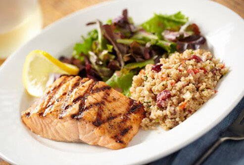 Photo of salmon, quinoa and salad dinner.
