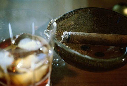 Photo of cigar and cocktail.