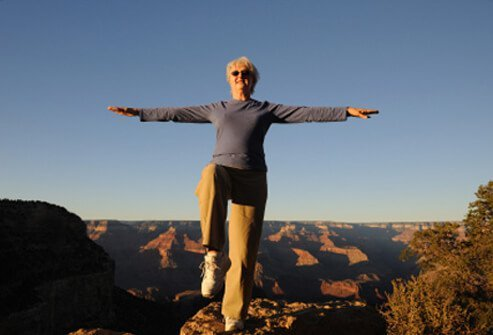 A woman balances and practices Tai Chi.