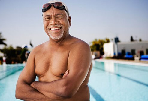 Healthy mature man by the pool, controlling heart disease risks.