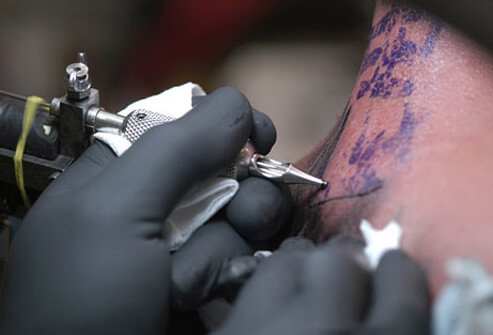 Close-up photo of person getting a tattoo.