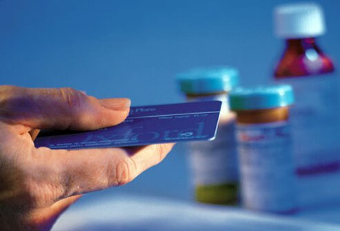 A photo of a man paying with his credit card for HIV/AIDS treatment medication.