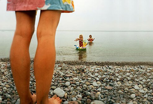 A photo of children at beach swimming.