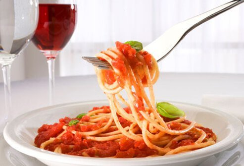 Spaghetti dinner with red wine.