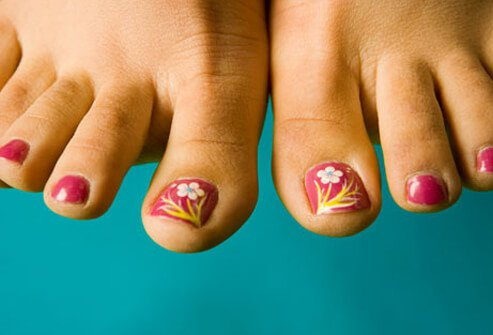 Floral painting on toenails.