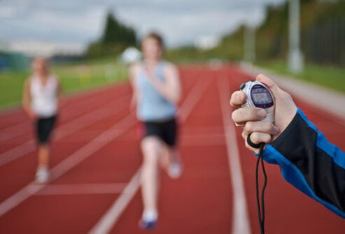 Runners on a track being timed.