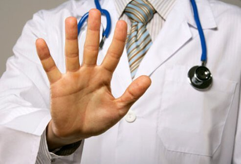 A doctor signals the motion to stop.