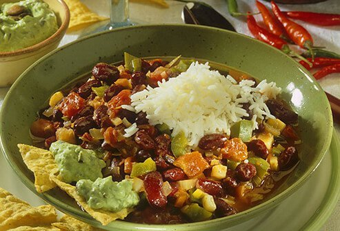 A bowl of vegetarian chili with beans and rice.
