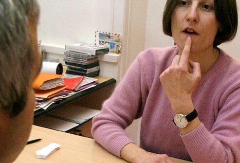 A stroke patient being helped by a speech therapist for rehab.