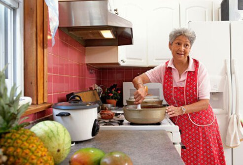 A rehabilitated stroke victim cooking at home.