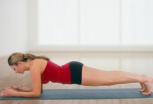 Photo of woman doing plank.
