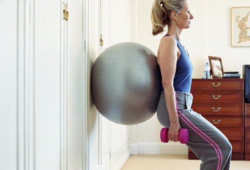 Photo of squat with exercise ball.