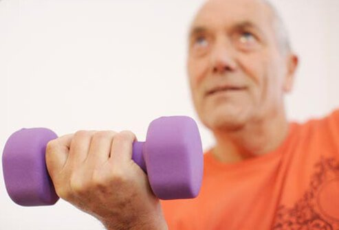 Photo of man lifting dumbbell.