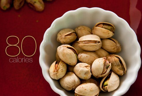 A bowl full of 20 pistachios.