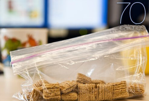 A sandwich bag filled with dry oat square cereal.