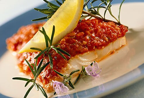 Photo of cod with tomato sauce and rosemary.