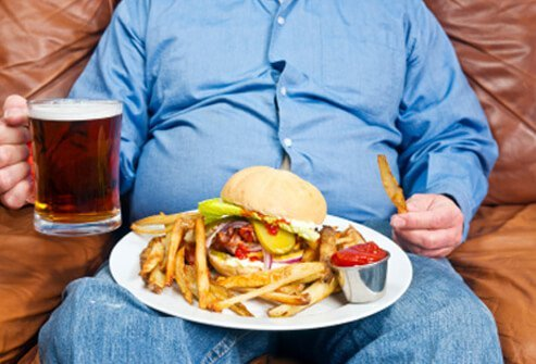 A man prepares to eat a large meal.