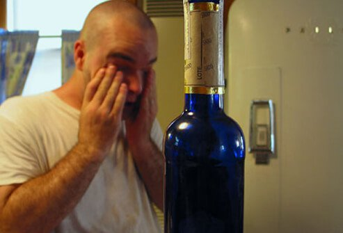 Man with a pounding headache after drinking/
