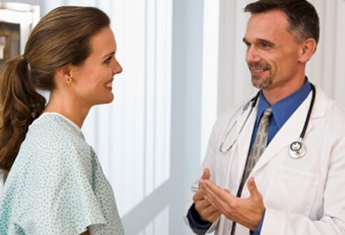 A woman talks with her doctor.
