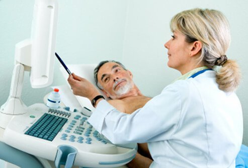 A senior patient receives an ultrasound examination.