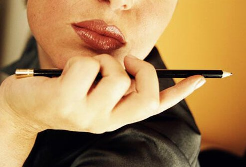 Photo of a woman holding a pencil.
