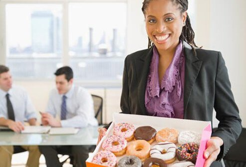 Photo of a woman with donuts.