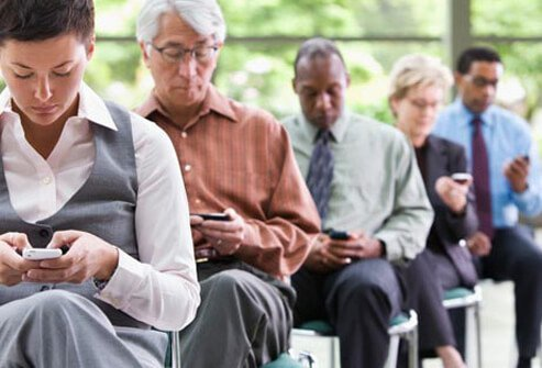 Photo of people texting.