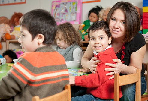 A mom with her son at school in the classroom.