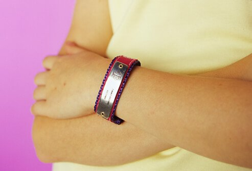 A medical bracelet on a young girl's arm.