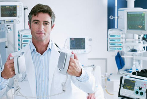 Photo of doctor with defibrillator.