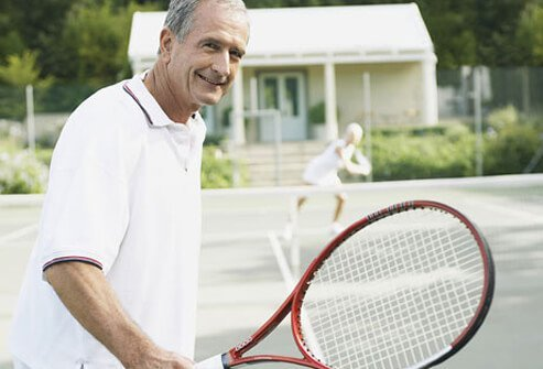 Photo of senior man playing tennis.