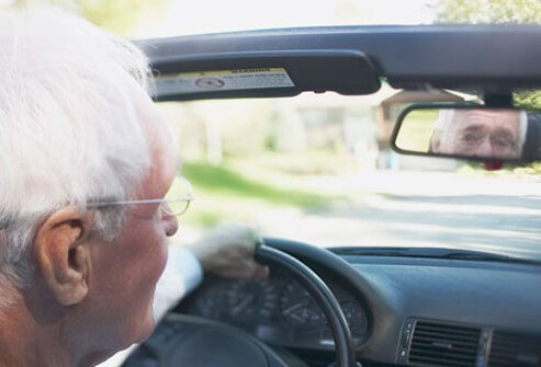 Photo of senior man driving.