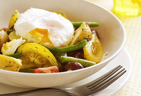 Photo of a poached egg salad.
