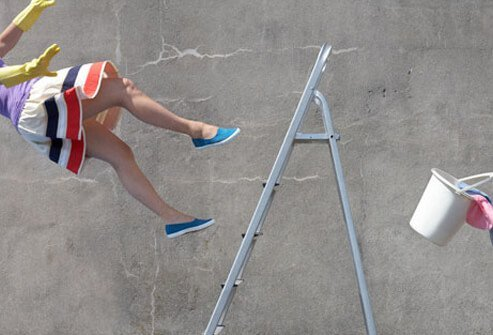 Woman falling off of a ladder.