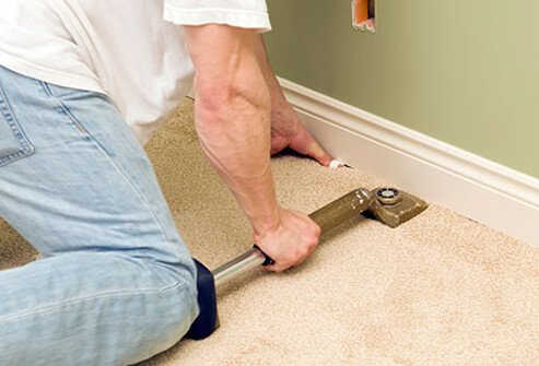 Knee bursitis can be caused by direct trauma to the knee as shown here with a person using a knee kicker to install carpet.