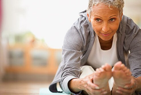 Photo of caregiver stretching after exercise.
