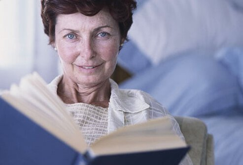 Photo of older woman reading.