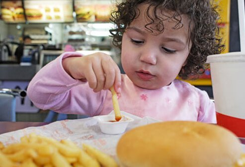 A child eating fast food.