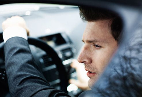 Photo of a man driving.