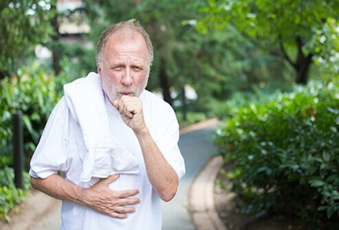 A man coughing after exercise.