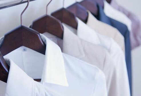 Photo of dress shirts on hangers.