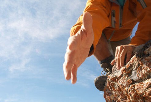 Photo of a climber reaching out for help.