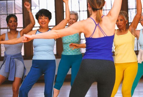 A group of woman working out together.