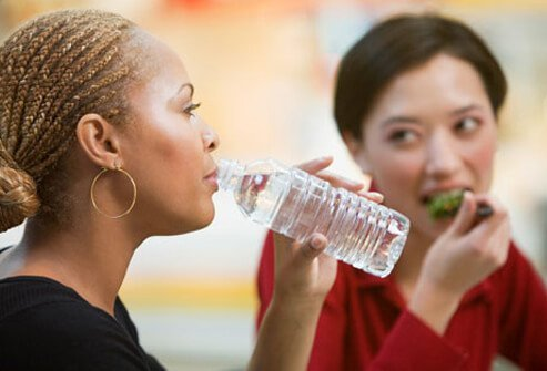 Photo of two women eating.