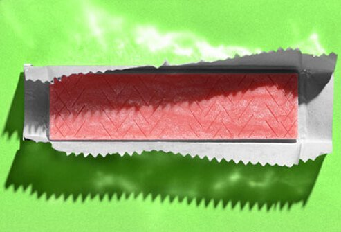 A photo of a stick of chewing gum in foil.