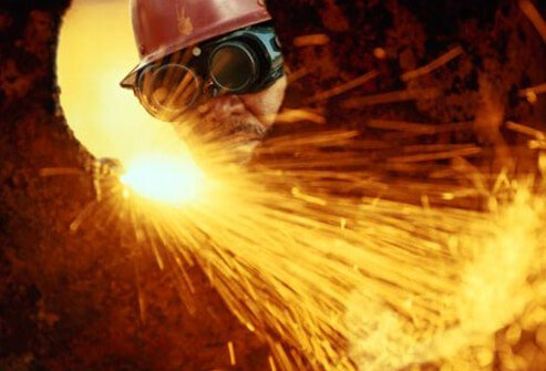 Photo of man welding.