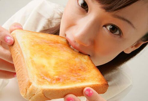 Photo of girl eating toast.